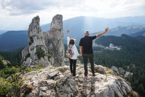 Elderly couple that have hiked to the top of a mountain in Kelowna