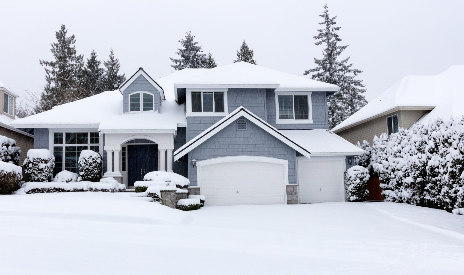 luxury-home-exterior-after-snowfall